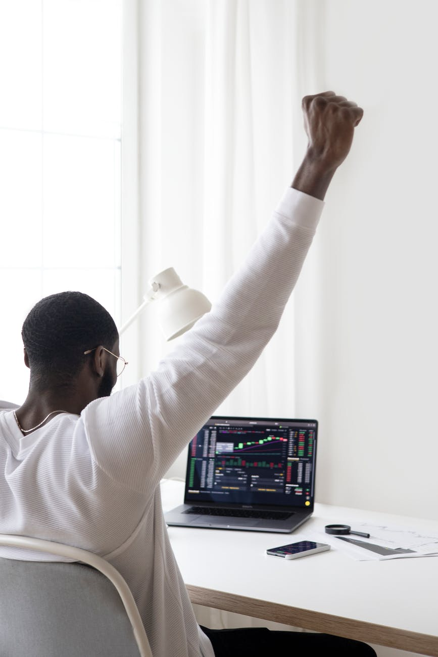 photo of person putting his hands up
